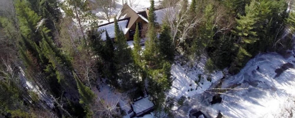 Bird's eye view of The River House and Au Sable River