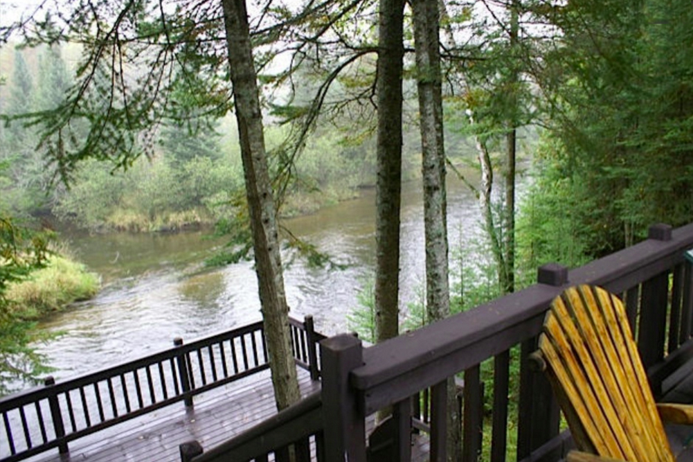 View of the Au Sable River from The River House's multi-level deck.